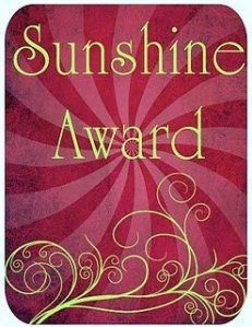 "Sunshine Award  ""light up the dark corners of our minds"""